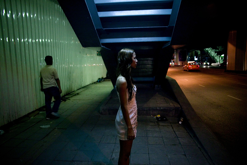 Bangkok, June 21, 2008 : a sex worker stands in a street in Bangkok waiting for customers.