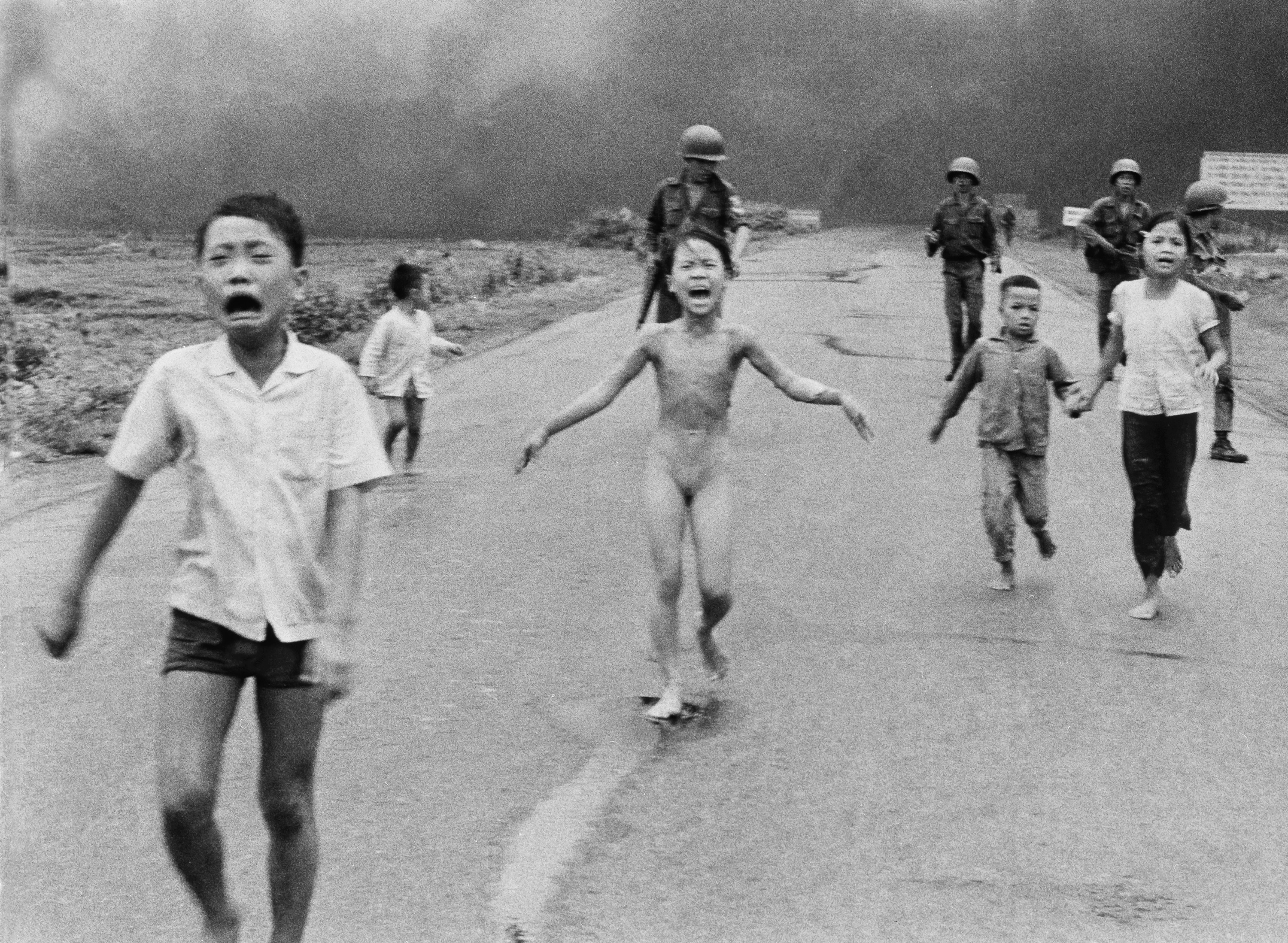FILE - In this June 8, 1972 file photo, South Vietnamese forces follow after terrified children, including 9-year-old Kim Phuc, center, as they run down Route 1 near Trang Bang after an aerial napalm attack on suspected Viet Cong hiding places. A South Vietnamese plane accidentally dropped its flaming napalm on South Vietnamese troops and civilians. The terrified girl had ripped off her burning clothes while fleeing. The children from left to right are: Phan Thanh Tam, younger brother of Kim Phuc, who lost an eye, Phan Thanh Phouc, youngest brother of Kim Phuc, Kim Phuc, and Kim's cousins Ho Van Bon, and Ho Thi Ting. Behind them are soldiers of the Vietnam Army 25th Division. (AP Photo/Nick Ut, File)